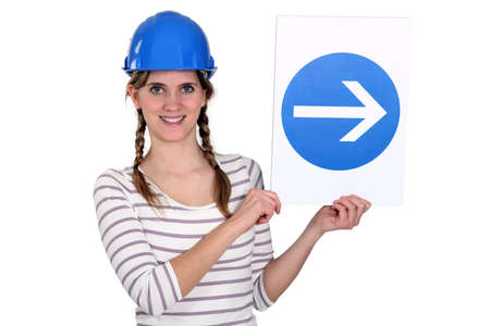 Woman wearing hard hat photo