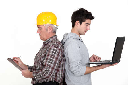Manual worker stood back to back with teenager Stock Photo - 16472047