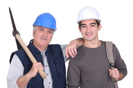 A mature construction worker and his grandson  photo
