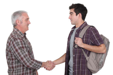 greeting people: Two casual men shaking hands