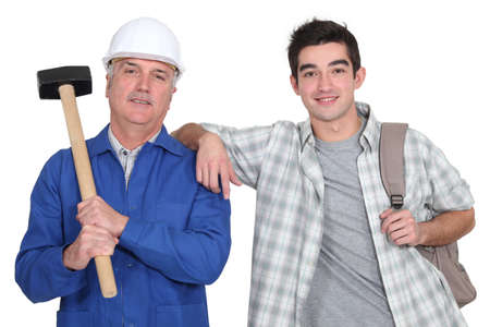A construction worker and his trainee  Stock Photo - 16471938