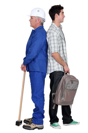 supported: Senior man and younger with backpack Stock Photo