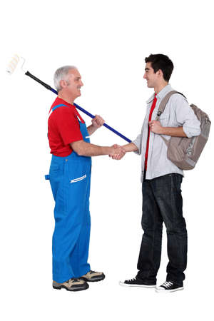 Decorator welcoming a new apprentice Stock Photo - 16472328