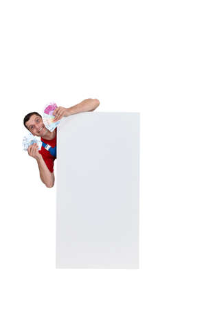 Rich man standing behind a blank sign Stock Photo - 16471765