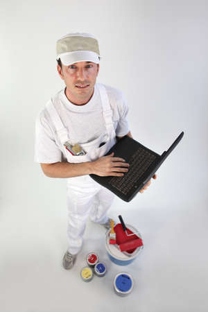 High-angle shot of a painter using his laptop photo