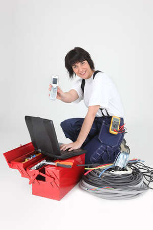 computer repairing: Female labourer with tools and telephone