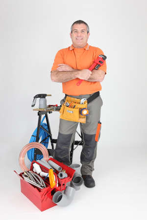 Studio shot of a plumber with tools of the trade photo