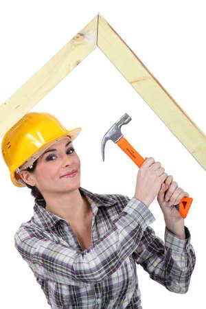 Woman building truss Stock Photo - 16554219