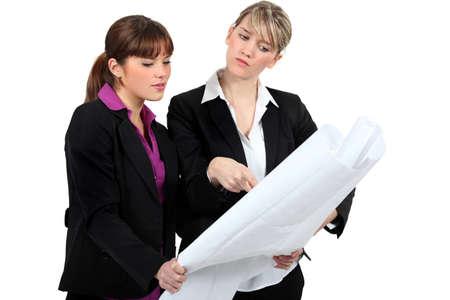 deployed: Women looking at a plan Stock Photo