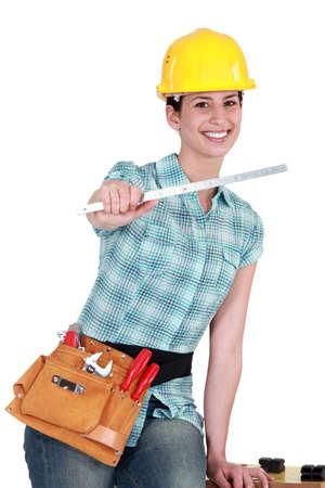workwoman: Tradeswomanwith a ruler