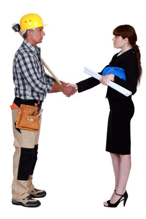 reforming: Architect and construction worker shaking hands