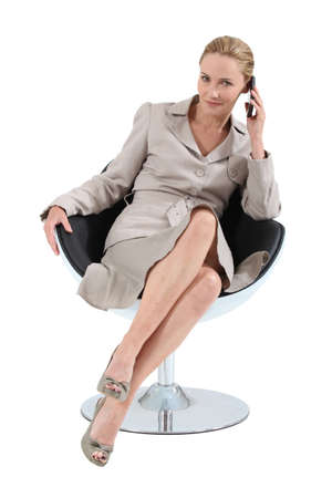 peep: Smart executive woman using a telephone Stock Photo