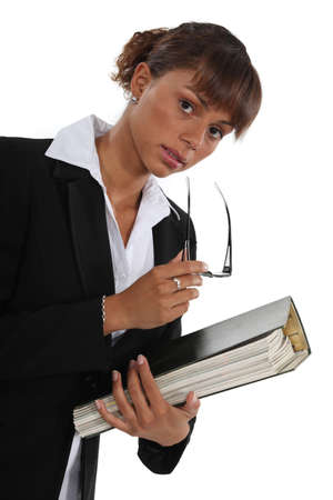 Woman holding folder full of paperwork photo