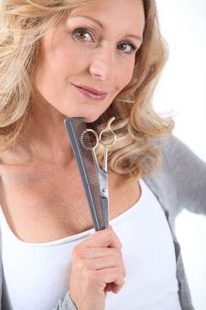 perm: Hairdresser with scissors