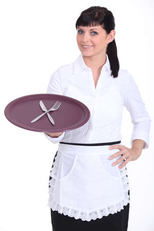 usher: Brunette waitress holding tray Stock Photo