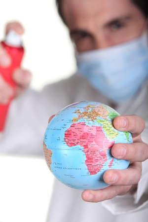 Doctor holding miniature globe Stock Photo - 16554416