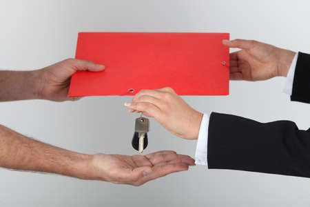 key handover: Exchanging signed contract for keys