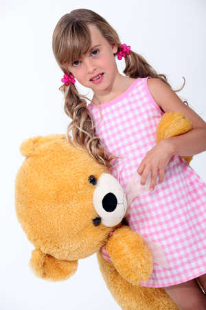 Girl with a stuffed toy Stock Photo - 16555125