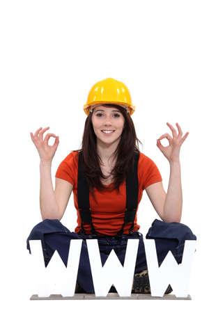 tradesperson: Tradeswoman thankful for modern technology Stock Photo