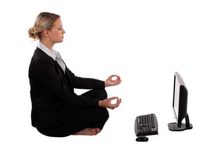 doing business: young pretty businesswoman doing yoga Stock Photo