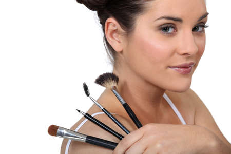 cute brunette with make-up brushes Stock Photo - 16548149
