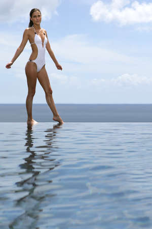 Woman stood by infinity pool Stock Photo - 16546976