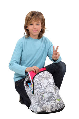school age boy: boy preparing his school bag Stock Photo
