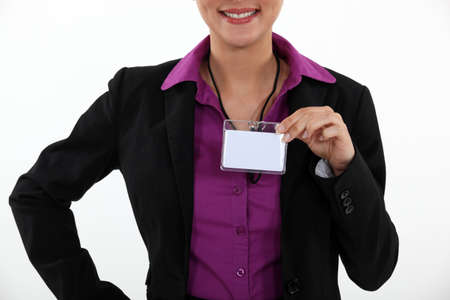 identification card: Woman displaying visitor badge
