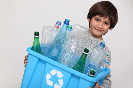 waste recycling: Child recycling plastic bottles Stock Photo