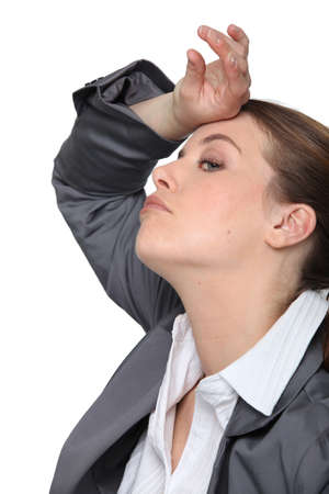 disinterested: Stressed young businesswoman