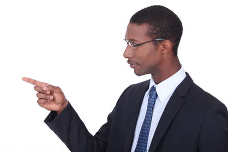Profile shot of a man in a suit pointing his finger photo