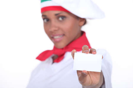 Pizzeria chef holding business card photo