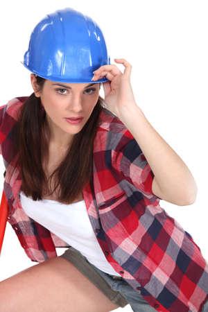 put forward: Woman with blue helmet