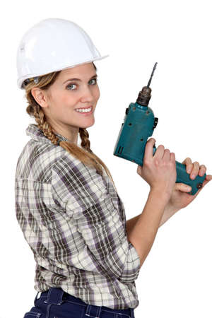 craftswoman: Female craftswoman holding drill Stock Photo
