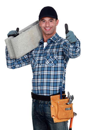 Builder carrying building block photo