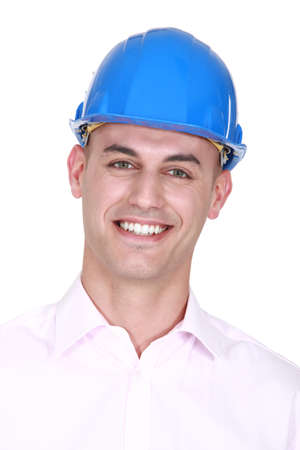 Smiling man wearing a hardhat Stock Photo - 16546959
