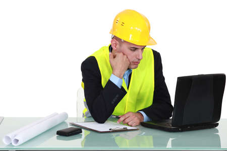 site manager: architect working on laptop
