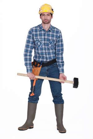 sledgehammer: Man holding sledge-hammer Stock Photo