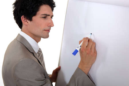Man drawing on flip chart Stock Photo - 16546842
