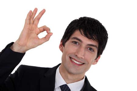 A businessman gesturing an ok sign Stock Photo - 16547026
