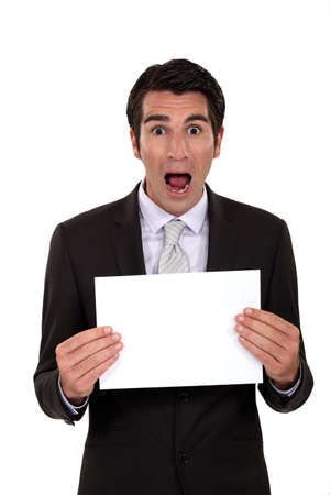 Shocked businessman holding poster photo