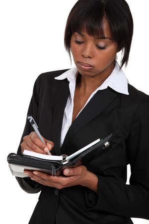 fedup: Fed-up businesswoman writing in her agenda