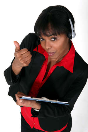 A black woman answering a hotline. Stock Photo - 16554038