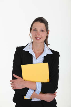 Brunette holding yellow folder photo