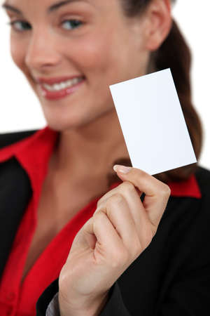 smiling young businesswoman showing business card Stock Photo - 16546988