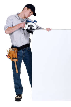 Tradesman using a circular saw photo