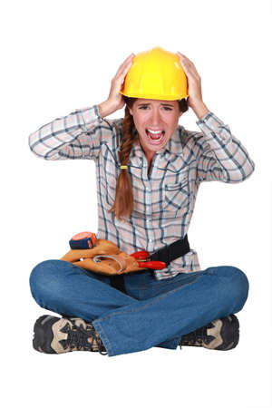 tradeswoman: Portrait of a screaming tradeswoman Stock Photo