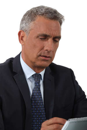 A portrait of a mature businessman taking notes Stock Photo - 16546869