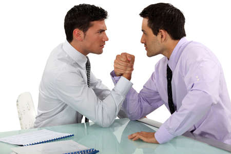 Businessmen arm wrestling photo