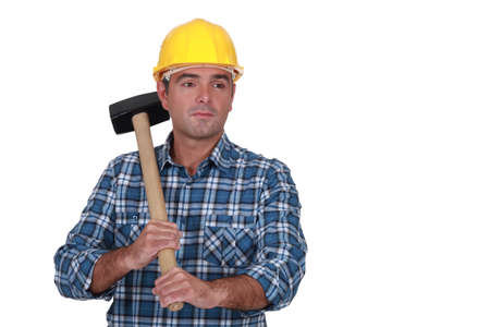 Man in plaid shirt holding heavy hammer Stock Photo - 16546974